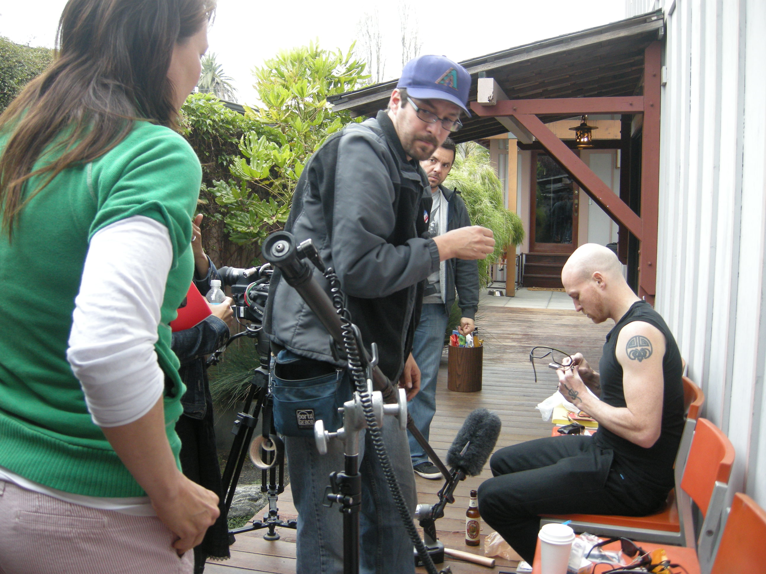 Jose Cabaco and Caskey Ebeling directing the documentary, starring James Powderly in the wife-beater.